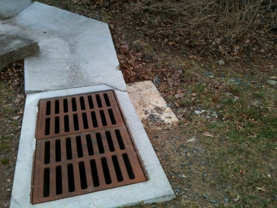 concrete storm drain with erosion