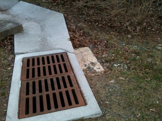 concrete storm drain with erosion