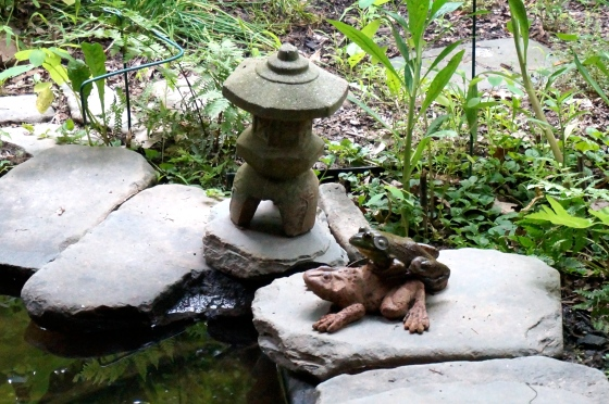 frog on frog statue