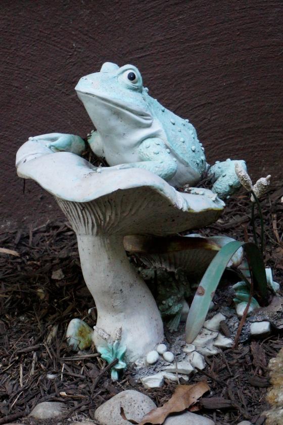 frog on mushroom statue