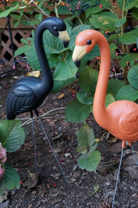 black & orange flamingo statues