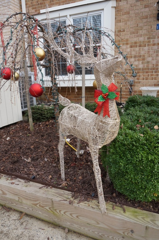 Holiday deer wildlife statue